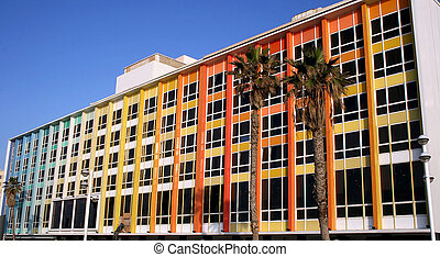 Modern office building on blue sky background in Tel-Aviv,...