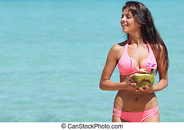 Woman with coconut cocktail on beach - Beautiful smiling...