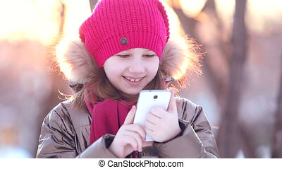 young girl writes on the phone HD