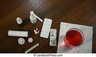 pills and thermometer on the table.