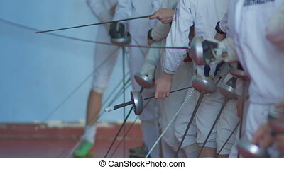 many fencers with rapiers before competition - many fencers...