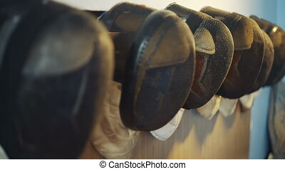 fencing mask on the wall - equipment fencing mask hanging on...