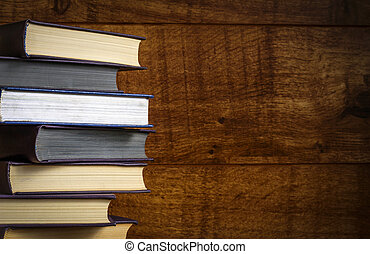 Old book on wooden background. Stock photo