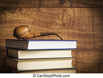 Old book on wooden background. - Old book and smoking pipe...