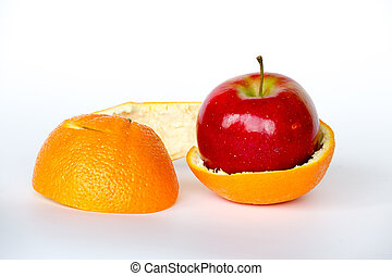 Apple inside an orange - GMO are living organisms whose...