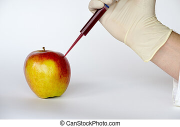 Injecting into an apple - GMO are living organisms whose...