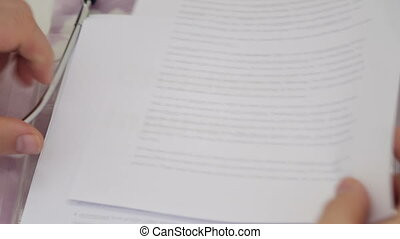 Shot of Doctor Holding Childbirth injuries papers -...