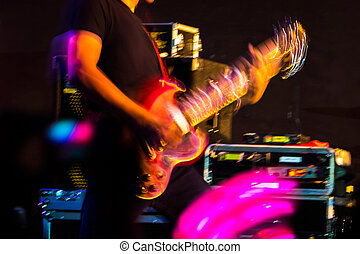 guitarist on stage - motion bur of a guitarist on stage...