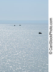 Fishermen in a boat on the sea