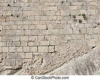 old wall of stone blocks - Wall from old bricks made of...