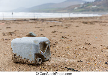Plastic bottle litter on the beach - Close up photo of a...