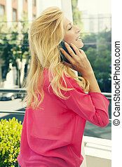 Cute blonde talking on a cell phone