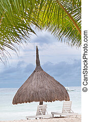 on the beach - tropical hut and seabed on idilic sea shore