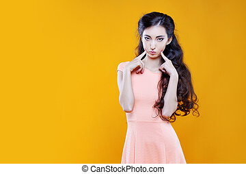 Fashion asian young girl. Portrait on yellow background. -...