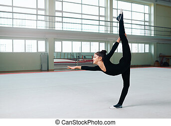 gymnast performs a balance with split. - The gymnast...