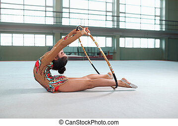 girl in gymnastic dress doing exercise with hoop - Little...