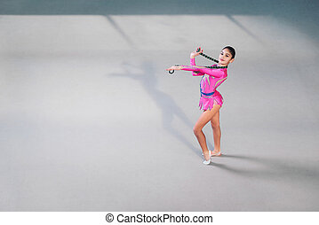 Portrait of female gymnast looking at camera - Portrait of...