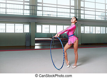 Little female gymnast posing with hoop - Little female...