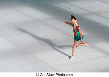 girl gymnast performs dance in gymnastics - cheerful girl...