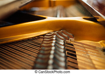the internal parts of grand piano strings - the internal...