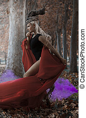meditation, blonde girl with a huge red cloth in the wind,...