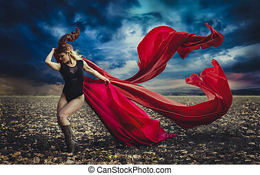 blonde girl with a huge red cloth in the wind, warrior and...
