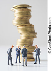 Businessmen thinking in front of coins