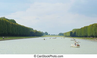 quot;canoeing versailles palace lake on boat, paris, france,...