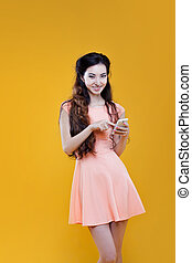Fashion asian young girl with mobile phone. Portrait on...