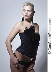 Girl in corset - Beautiful young woman with short hair in...