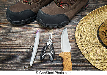 fishing tackles and fishing gear on wooden background, top...
