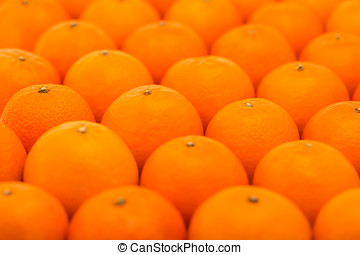 Fresh, juicy, bright tangerines with embossed skin photographed with a small depth of field