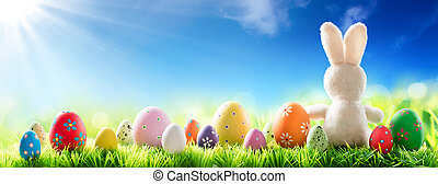 Bunny With Decorated Eggs On Sunny Meadow - Spring And...