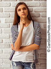 Cute teenage girl - Portrait of a cute thoughtful teenage...