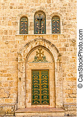Church of the Holy Sepulchre detail green door and three...