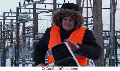 Electrician checking snow shovel