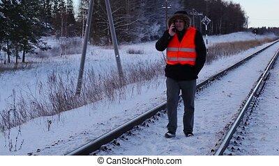 Railway employee using smartphone