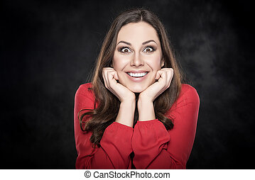 Surprised woman over dark background - Portrait of surprised...