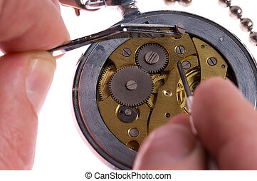 Watchmaker or repair man in action, repairing old watch with...