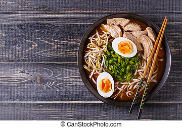 Japanese ramen soup with chicken, egg, chives and sprout. -...