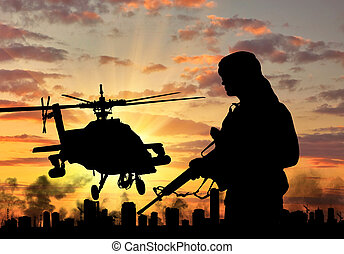 Silhouette of a terrorist and a helicopter - Concept of...