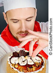 confectioner - Portrait of a male confectioner cooking a...