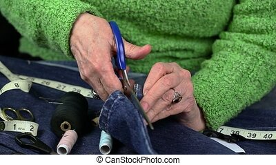 Woman using small scissors