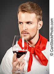 sommelier - Male sommelier tasting red wine. Winemaking....