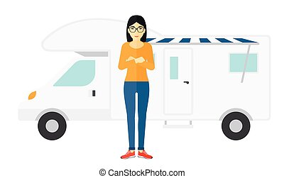 Woman standing in front of motor home - An asian woman...