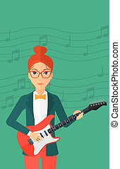Musician playing electric guitar - A smiling woman playing...