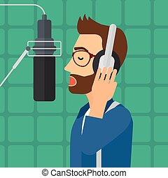 Singer making record. - A hipster man in headphones making a...