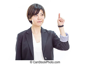 Asian businesswoman pressing invisible screen