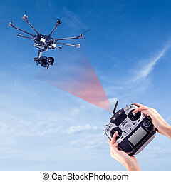 Man controls the flying drones - Hands of a man with a radio...