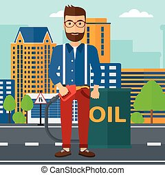 Man with oil can and filling nozzle - A hipster man with the...